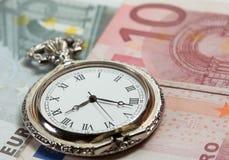 Reloj de plata con curerrency EURO Imágenes de archivo libres de regalías