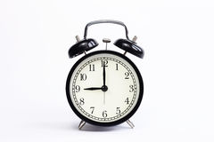 Reloj de tabla clásico en un fondo blanco Imagen de archivo libre de regalías