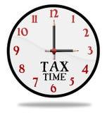 Reloj de tiempo del impuesto Foto de archivo libre de regalías