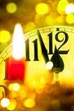 Reloj del Año Nuevo con la vela llameante Imagen de archivo libre de regalías