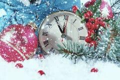 Reloj del Año Nuevo con las bolas de la Navidad Imagen de archivo libre de regalías
