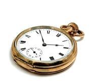 Reloj del bolsillo en oro Fotografía de archivo