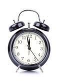 Reloj del ` de 12 O en el despertador en blanco Imágenes de archivo libres de regalías