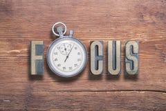 Reloj del foco de madera Imágenes de archivo libres de regalías