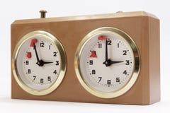 Reloj del juego en el fondo blanco Imágenes de archivo libres de regalías