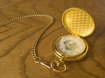 Reloj del oro Imágenes de archivo libres de regalías