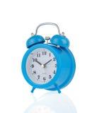 Reloj del reloj de alarma en blanco Fotos de archivo