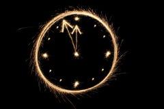 Reloj del Sparkler Imágenes de archivo libres de regalías