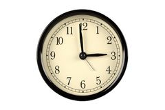 Reloj del vintage contra fondo aislado Imagenes de archivo