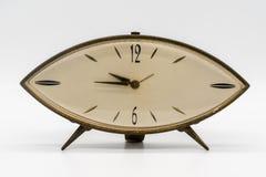 Reloj del vintage, despertador en el fondo blanco Foto de archivo libre de regalías