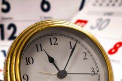 Reloj en calendario Foto de archivo libre de regalías