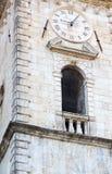Reloj en la catedral de St Tryphon, Kotor, Montenegro Fotografía de archivo libre de regalías