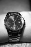 Reloj en la mano Foto de archivo libre de regalías