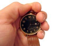 Reloj en la mano aislada Imagen de archivo