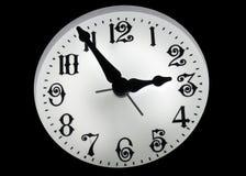 Reloj en la obscuridad Fotos de archivo libres de regalías