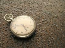 Reloj en lluvia Imágenes de archivo libres de regalías