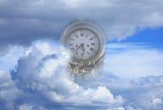 Reloj en nubes Imágenes de archivo libres de regalías