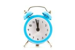 Reloj en un fondo blanco imágenes de archivo libres de regalías
