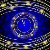 Reloj en un fondo festivo azul Fotos de archivo libres de regalías