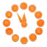 Reloj hecho de círculo de las zanahorias Imagen de archivo libre de regalías