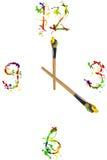Reloj hecho de la pintura y de los painbrushes Imagenes de archivo