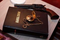 Reloj ligero del arma de la biblia Imagen de archivo libre de regalías