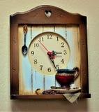 Reloj montado en la pared de la cocina imagen de archivo libre de regalías