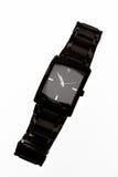 Reloj negro elegante aislado en el fondo blanco Imágenes de archivo libres de regalías