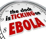 Reloj que hace tictac en virus mortal de la enfermedad de la parada del tiempo de Ebola Fotografía de archivo