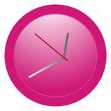 Reloj redondo rosado con el modelo de la pendiente Foto de archivo libre de regalías