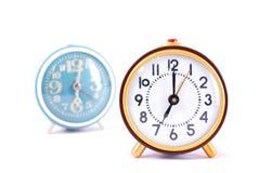 Reloj retro aislado en el fondo blanco Imagen de archivo