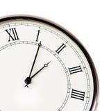 Reloj retro con los dígitos romanos. Fotos de archivo