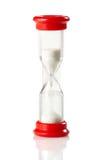 Reloj rojo de la arena imagen de archivo libre de regalías