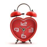 Reloj rojo del corazón Imagen de archivo