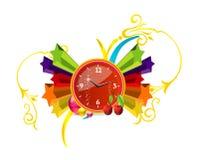 Reloj rojo en las estrellas coloreadas Fotografía de archivo