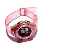Reloj rosado aislado en blanco Imagenes de archivo