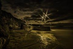 Reloj TowerPier de Knockadoon en la noche Fotos de archivo libres de regalías