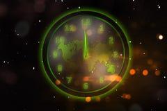 Reloj verde que brilla intensamente con el mapa del mundo Foto de archivo