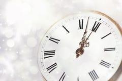 Reloj viejo con las estrellas y los copos de nieve Fotografía de archivo