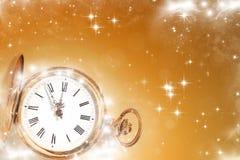 Reloj viejo con las estrellas y los copos de nieve Foto de archivo libre de regalías