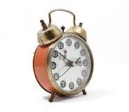 Reloj viejo en el fondo blanco Fotos de archivo libres de regalías
