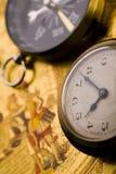 Reloj y compás Fotografía de archivo libre de regalías