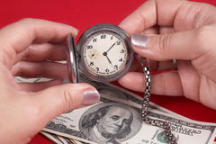 Reloj y dólares Foto de archivo