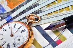 Reloj y dólares de bolsillo Fotos de archivo libres de regalías