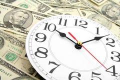 Reloj y dólares de pared fotografía de archivo