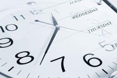 Reloj y días de la semana Imagen de archivo