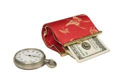Reloj y dinero Fotografía de archivo