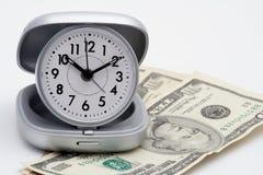 Reloj y dinero (dólares) Foto de archivo libre de regalías