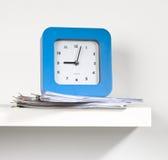 Reloj y documento Foto de archivo libre de regalías
