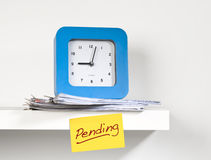 Reloj y documento Foto de archivo